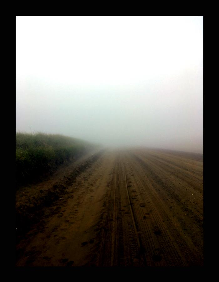 The image is of a foggy road. It symbolizes the unknown up ahead.