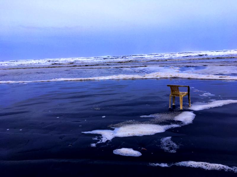 A Chair beside the ocean represents the infinite potential to manifest change in one's life